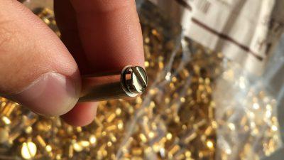 Polished brass bolt